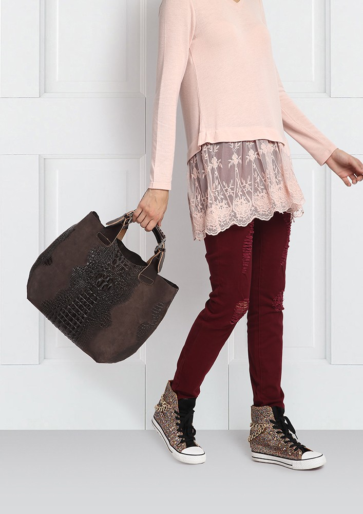 DISTRESSED LEATHER BAG WITH RIVETS